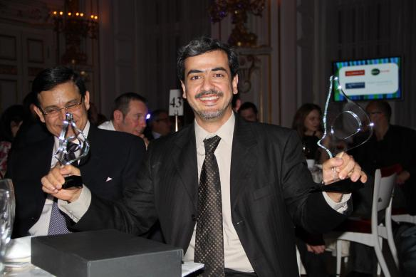Adalid's founder Yahya holding the SABRE awards in his hands